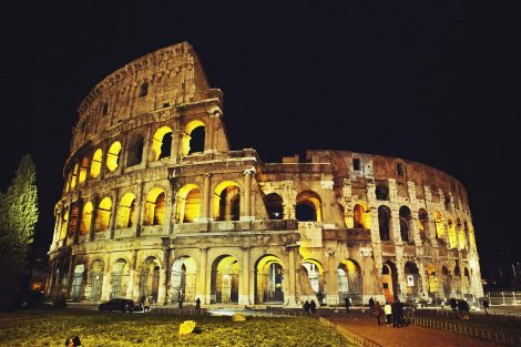 Colosseum lit up in the dark