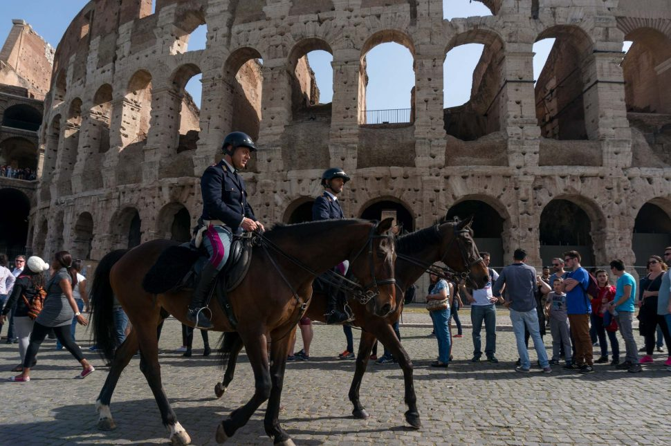 Italian military police, the Carabinieri, patrolling on horseback near the Colosseum